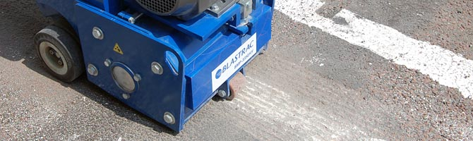 Image of scarifier removing line markings on road