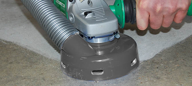 Blastrac hand held floor grinder in action